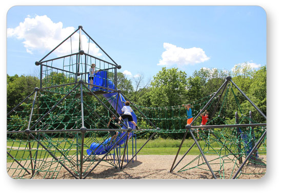 Children climbing a Meteor Frame Net with Fort connected with a Bridge to a Meteor Regular