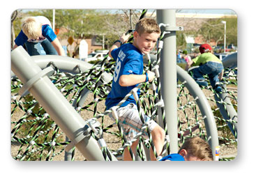 IM-1007 - Boy Traversing a Rope Course