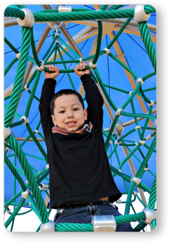 Boy Hanging Onto Rope