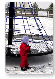 Child Playing on Snow Covered Apollo