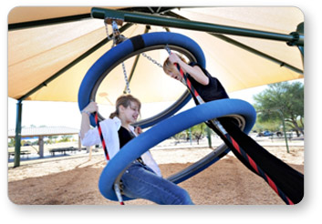 Two girls swinging on a Biggo Tres