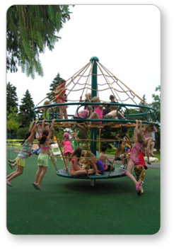 Children spinning on an Astro Rotating Climber